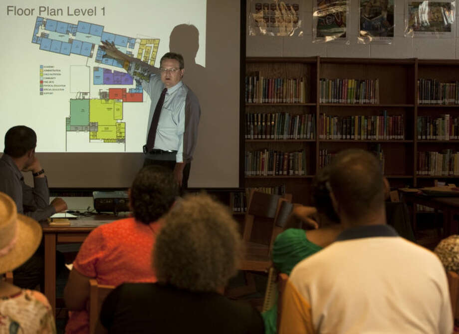 MISD Superintendent Ryder Warren talks about the preliminary design areas of Bunche Elementary during a public meeting Thursday evening at Carver Center. Tim Fischer\Reporter-Telegram Photo: Tim Fischer