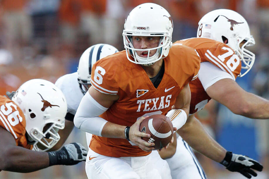 FILE - In this Sept. 10, 2011, file photo, Texas' Case McCoy (6) hands off during the first quarter on an NCAA college football game against BYU, in Austin, Texas. Texas' David Snow (78) blocks on the play. McCoy, younger brother of former Texas quarterback Colt McCoy, came off the bench to help spark the Longhorns to a 17-16 come-from-behind win over BYU and could get his first start when No. 24 Texas plays at UCLA on Saturday, Sept. 17, 2011. (AP Photo/Eric Gay, File) Photo: Eric Gay / AP2011