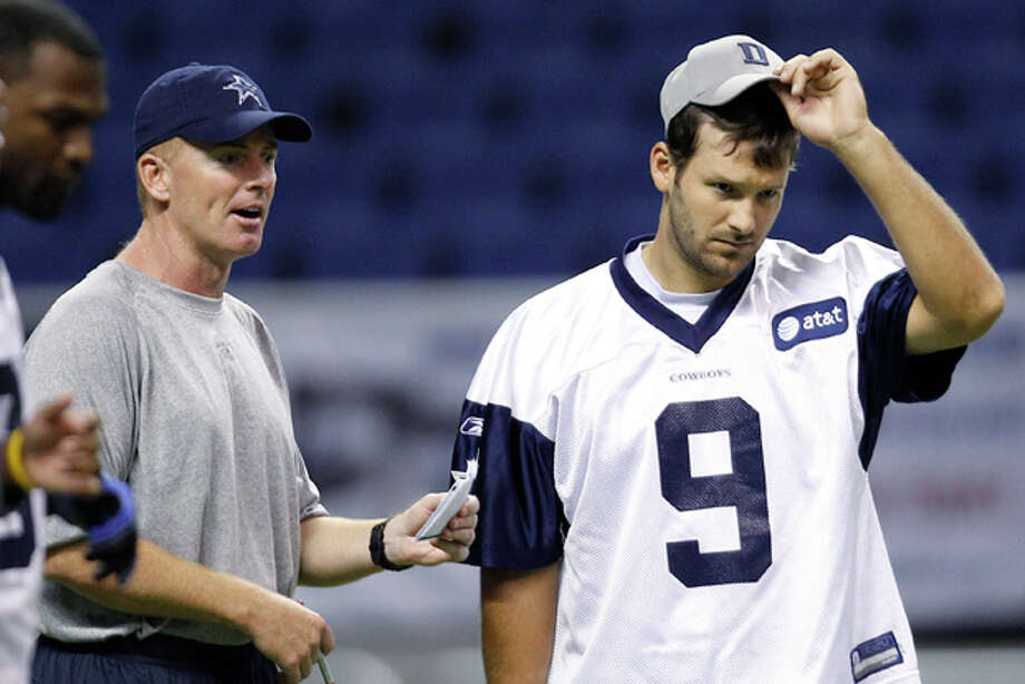 "FILE - This July 29, 2011, file photo shows Dallas Cowboys coach Jason Garrett, left, talking with Tony Romo (9) during an NFL training camp walk through, in San Antonio. Garrett says Romo looks ""as normal as he can be,"" a good sign indeed for the Cowboys. (AP Photo/Eric Gay, File) Photo: Eric Gay / AP2011"