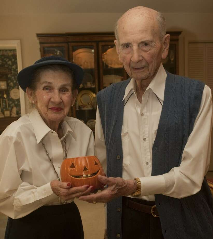 Marilyn and Chet LaRue are ready with candy to hand out on Halloween and celebrate their 70th wedding anniversary. Tim Fischer\Reporter-Telegram Photo: Tim Fischer