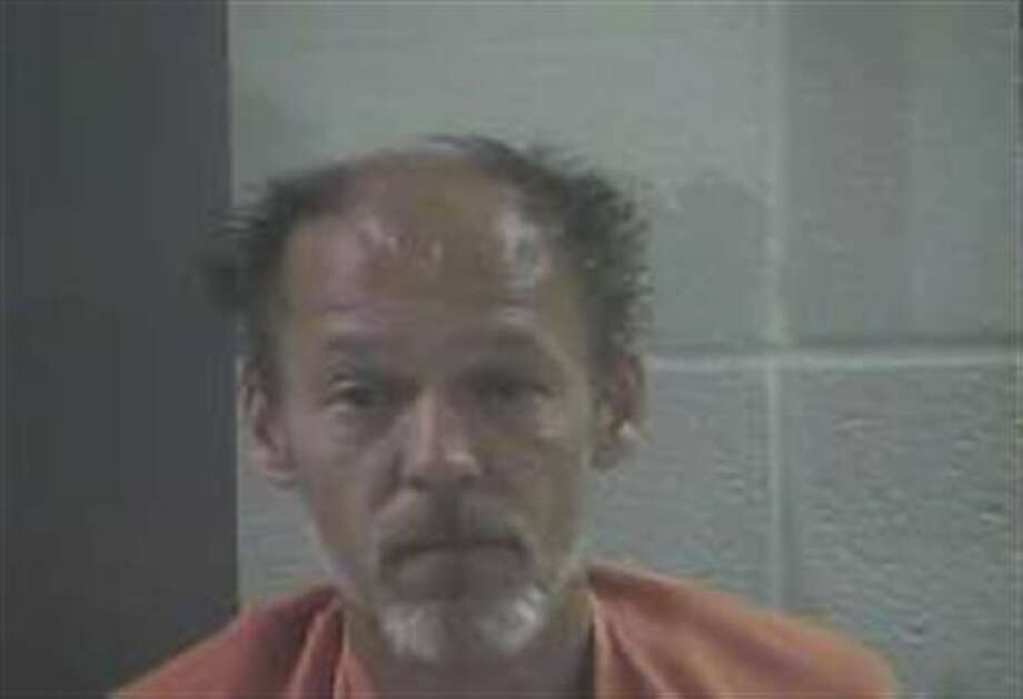 "This photo provided by London, KY Sheriff's office shows Ernest Chris Chumbley of London, Ky. Chumbley, 48, was charged Wednesday, Aug. 28, 2013, with murdering his wife but said he was only complying with her request to end her suffering from cancer. Chumbley, told WKYT-TV he fired the shots that killed Virginia M. Chumbley, 44, who he says had terminal breast cancer, but didn't commit the crime he is charged with. ""I shot her,"" he told the station from the Laurel County jail Wednesday. ""She died from my shots, but it's not murder."" He pleaded not guilty in Laurel County District Court and is scheduled for a preliminary hearing on Sept. 5. (AP Photo/London, KY Sheriff's office) Photo: HOPD / London, KY Sheriff's office"