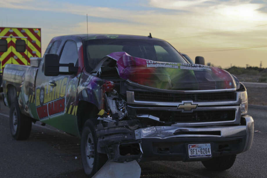 The driver of this pickup was transorted with minor injuries to Midland Memorial Hospital after a crash caused by a passenger van crossing over oncoming traffic Thursday on Highway 191. Tyler White/Reporter-Telegram Photo: Tyler White
