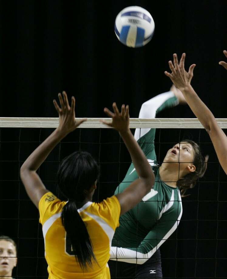 Midland Colleges Breanna Ruble goes up to spike the ball while Frank Phillips Rebecca Moustapha prepares to attempt the block Wednesday during their game at the Chaparral Center. Cindeka Nealy/Reporter-Telegram Photo: Cindeka Nealy