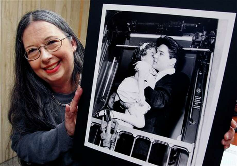 In this Sept. 28, 2012 photo, Margaret (Margie) Ann Crawford, holds a photo taken in 1960 of her as a child with Elvis Presley in Mabank, Texas. (AP Photo/The Dallas Morning News, Michael Ainsworth) MANDATORY CREDIT; MAGS OUT; TV OUT; INTERNET OUT; AP MEMBERS ONLY; NO SALES Photo: Michael Ainsworth / The Dallas Morning News
