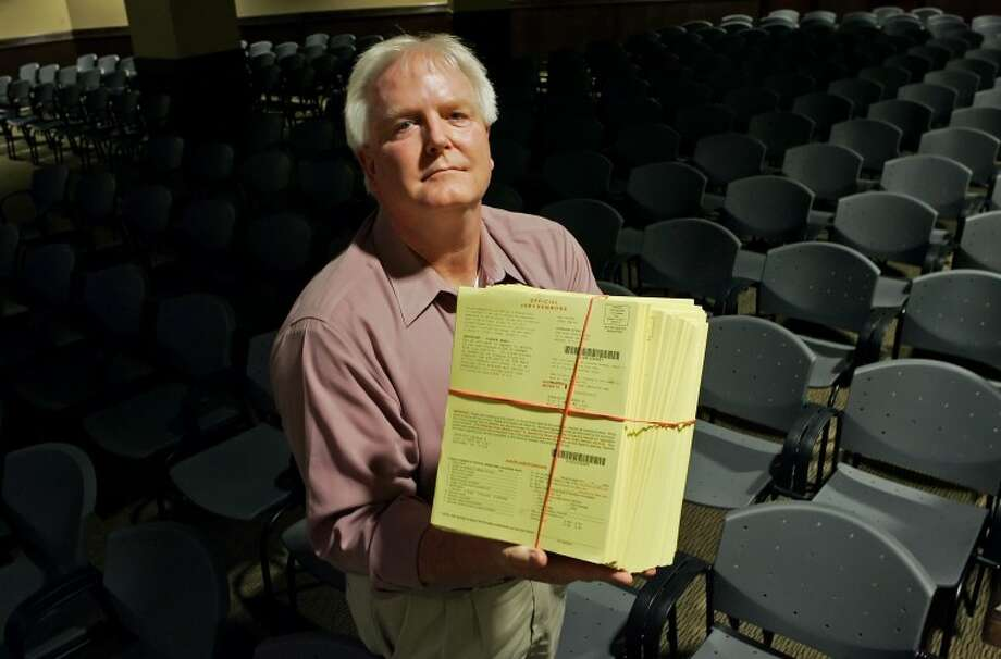 (2011 File Photo)Midland County District Clerk Ross Bush stands inside the Central Jury Room holding 750 jury summons that were to be mailed out three weeks before the day potential jurors report for duty. District judges are to hold a show-cause hearing Friday to allow people to explain why they haven't reported for jury duty. Photo: MRT File Photo