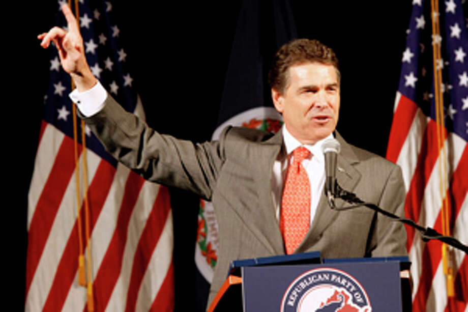 Republican Presidential candidate, Texas Gov. Rick Perry, gestures during a speech before a Virginia Republican fundraising event in Richmond, Va., Wednesday, Sept. 14, 2011. (AP Photo/Steve Helber) Photo: Steve Helber / AP