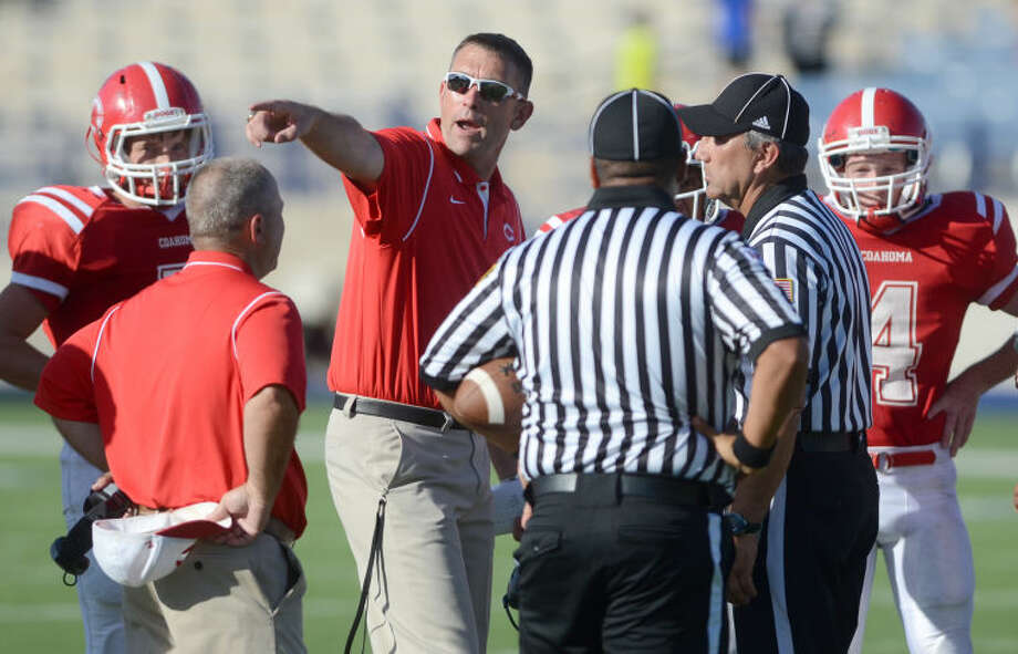 Coahoma coaches discuss a call with referees in a game against Forsan on Aug. 30 at Grande Communications Stadium. James Durbin/Reporter-Telegram Photo: JAMES DURBIN
