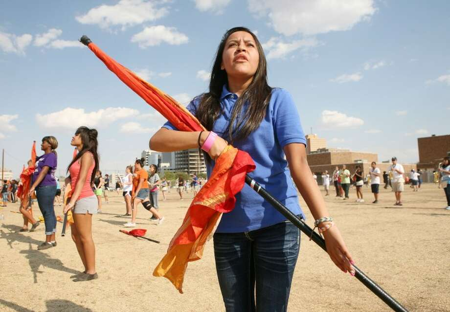 "Stephanie Hernandez, 15, practices her marching and color guard routine Tuesday during band practice for their ""Imagine"" halftime show at Midland High School. Photo: Cindeka Nealy/Reporter-Telegram"