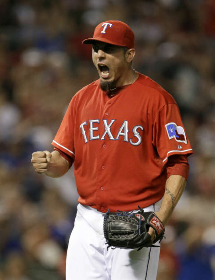 Texas Rangers starting pitcher Matt Garza (22) celebrates after getting the third out to end the top of the seventh inning against the Minnesota Twins on Saturday in Arlington. The Rangers won in walk-off style in the ninth, 2-1. (AP Photo/Tony Gutierrez) Photo: Tony Gutierrez