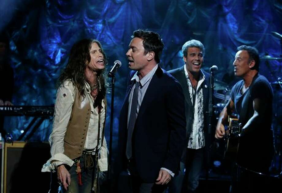 "In this photo provided by NBC, from left, Steven Tyler, Jimmy Fallon, Mark Rivera, and Bruce Springsteen, perform during ""Hurricane Sandy: Coming Together"" Friday, Nov. 2, 2012, in New York. Hosted by Matt Lauer, the event is heavy on stars identified with New Jersey and the New York metropolitan area, which took the brunt of this week's deadly storm. (AP Photo/NBC, Heidi Gutman) Photo: Heidi Gutman / NBC"