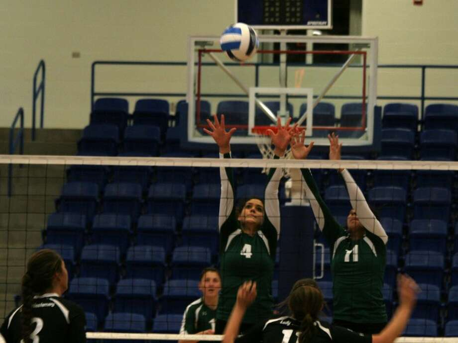 Midland College's Gaby Nieto (4) and Naomi Posada (11) go up for a block during Thursday afternoon's NJCAA Region V West Tournament final against Western Texas College at the Rip Griffin Center in Lubbock.Forrest Allen/Midland College Athletics