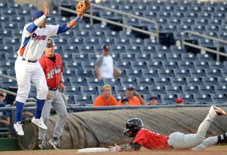 RockHounds third baseman Jefry Marte catches a throw to third base but not before Frisco's Odubel Herrera slides in safe Tuesday at Citibank Ballpark. James Durbin/Reporter-Telegram Photo: JAMES DURBIN