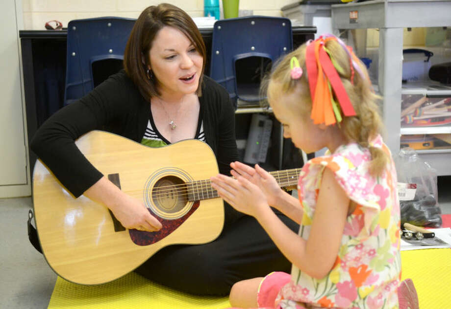 Kayla Minchew leads Sarah Bruehl, age 8, in a musical therapy session at MARC Tuesday. James Durbin/Reporter-Telegram Photo: JAMES DURBIN