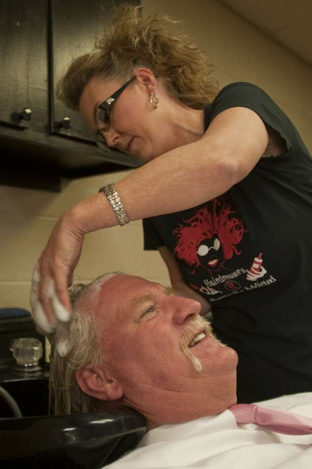 Oreda Marburger, stylist with Sophisti-Cuts Salon, washes James Henry's hair as they prepare to cut it for a donation to Locks For Love Tuesday morning. Tim Fischer\Reporter-Telegram Photo: Tim Fischer