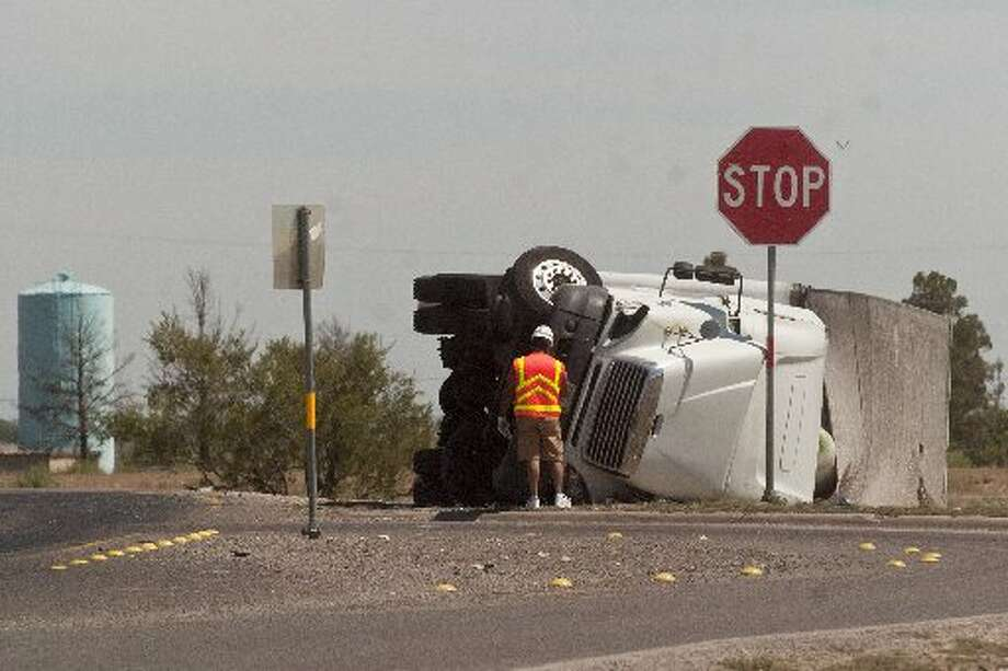 A tractor-trailed rolled over onto the driver's side after exiting the westbound lane of Interstate 20 onto the northbound lane of Farm-to-Market Road 1788.