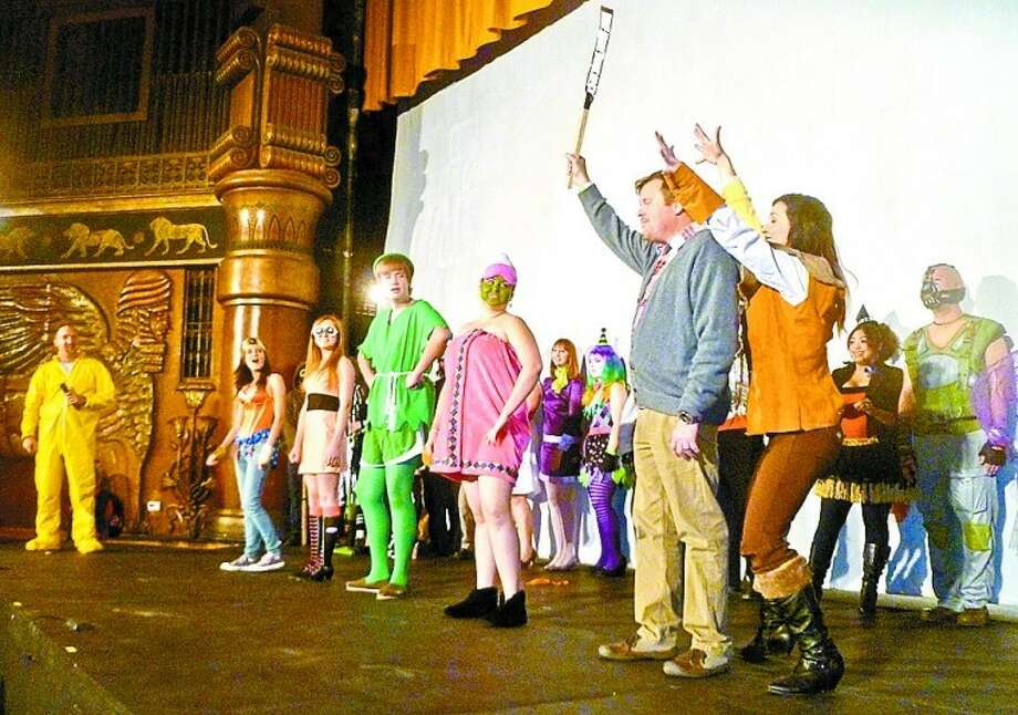 """People gather onstage at the Yucca Theatre for a costume contest judged by the audience at a screening of """"The Rocky Horror Picture Show."""" Tyler White/Reporter-Telegram Photo: Tyler White"""