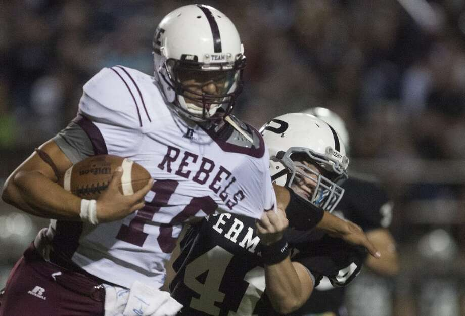 Permian's Chase Miller (41) tackles Midland Lee's Talor Nunez (10) during the game Friday at Ratliff Stadium. Photo: Albert Cesare|Odessa American