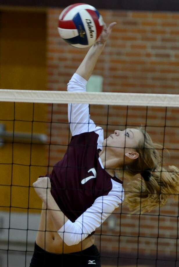 Lee High's Shauna Standard goes up for a kill Friday against Abilene High. Photo by Tim Fischer/Midland Reporter-Telegram Photo: Tim Fischer