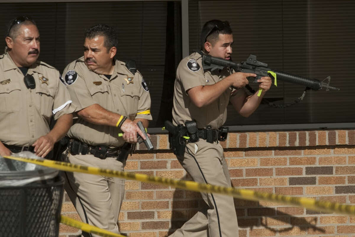 (File photo from school emergency drills) Midland police, MISD, Sheriff's Officers, DPS officers train on a shooter on campus drill Wednesday morning at Midland High School. Tim Fischer\Reporter-Telegram