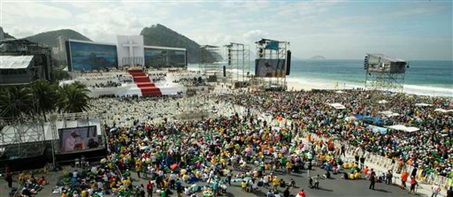 Pope Francis celebrates Mass on Copacabana beach, in Rio de Janeiro, Brazil, Sunday, July 28, 2013. Francis wrapped up is historic trip to his home continent Sunday with a Mass that drew a reported 3 million people. (AP Photo/Victor R. Caivano) Photo: Victor R. Caivano / AP