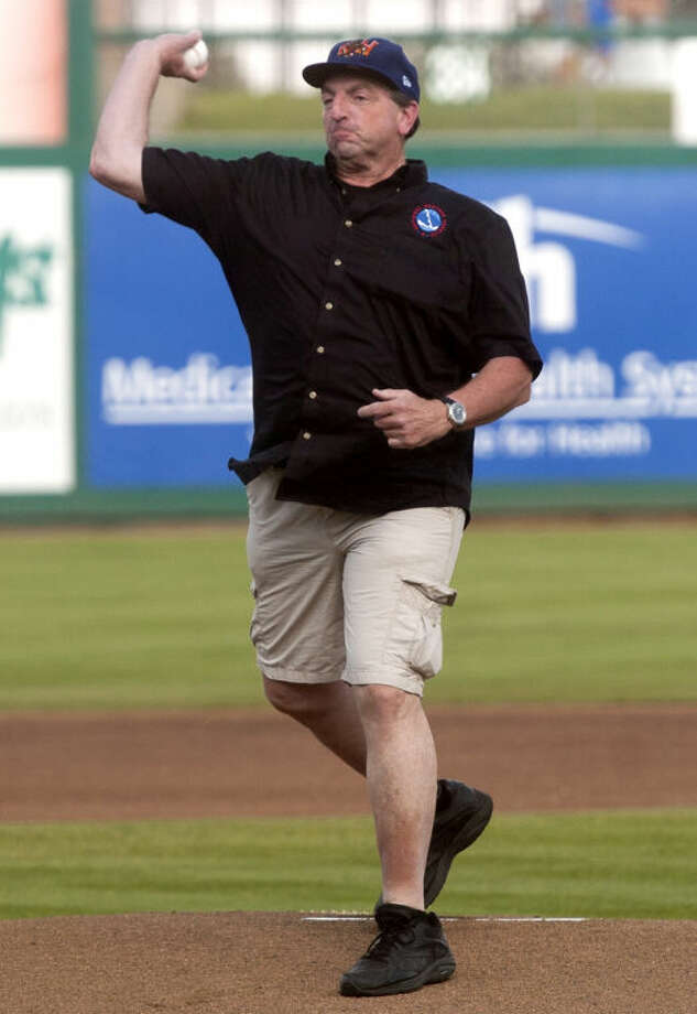 Mark Strobin, warning coordination meteorologist for the National Weather Service, throws out the ceremonial first pitch before the start of the Rockhounds game against Frsico Wednesday at Citibank Ballpark. James Durbin/Reporter-Telegram Photo: JAMES DURBIN