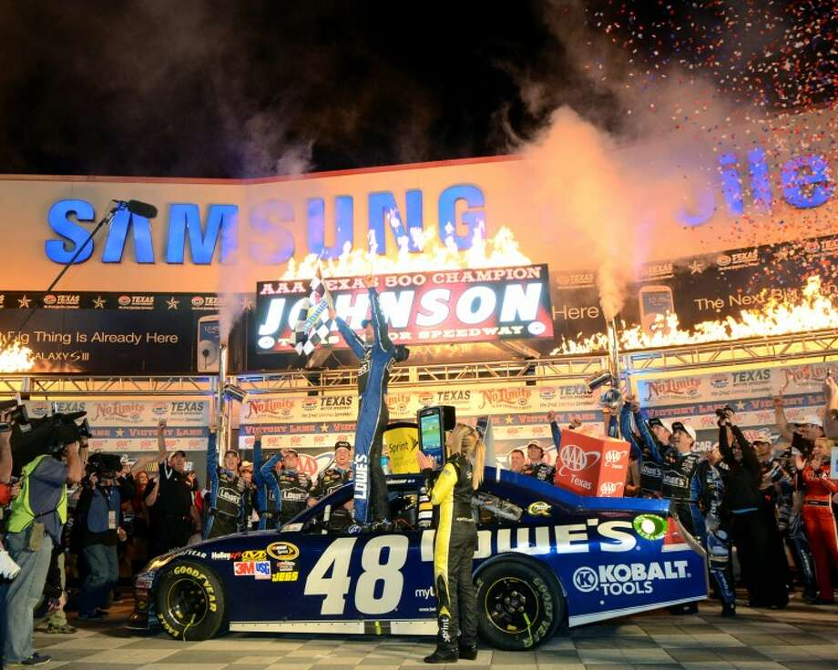 Jimmie Johnson, driver of the #48 Lowe's Chevrolet, celebrates in Victory Lane after winning the NASCAR Sprint Cup Series AAA Texas 500 Sunday at Texas Motor Speedway. James Durbin/Reporter-Telegram Photo: JAMES DURBIN