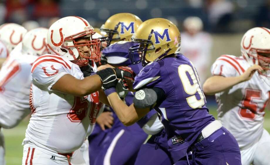 Midland High defensive end Travis Baur goes up against Odessa High outside lineman Jesus Adame Friday at Grande Communications Stadium. James Durbin/Reporter-Telegram Photo: JAMES DURBIN