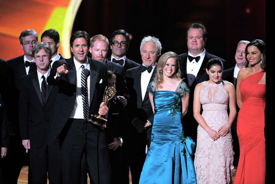 "Steven Levitan, center, and the cast and crew of ""Modern Family"" accept the award for outstanding comedy series at the 63rd Primetime Emmy Awards on Sunday, Sept. 18, 2011 in Los Angeles. (AP Photo/Mark J. Terrill) Photo: Mark J. Terrill / AP2011"