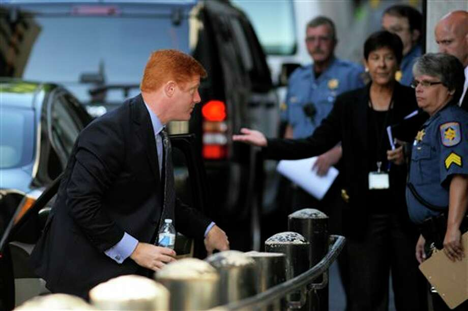 Former Penn State assistant football coach Mike McQueary enters the Dauphin County Courthouse, Monday, July 29, 2013, in Harrisburg, Pa. Graham Spanier, Gary Schultz and Timothy Curley are to go before a judge Monday to determine whether the three must face trial on charges they covered up an allegation that Jerry Sandusky was sexually preying on boys. (AP Photo/Bradley C Bower) Photo: Bradley C Bower / FR37962 AP