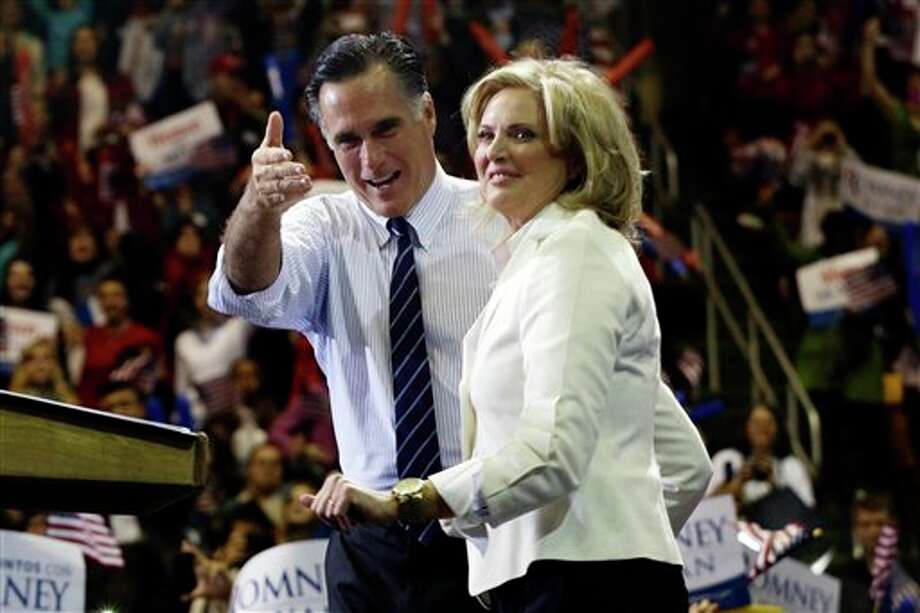 Republican presidential candidate and former Massachusetts Gov. Mitt Romney and wife Ann Romney stand on stage at a campaign rally at The Patriot Center at George Mason University in Fairfax, Va., Monday, Nov. 5, 2012. (AP Photo/Charles Dharapak) Photo: Charles Dharapak / AP