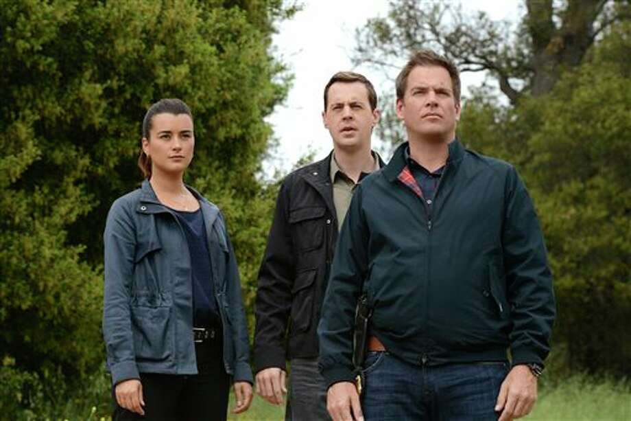 "This publicity image released by CBS shows, cast members, from left, Cote de Pablo, Sean Murray and Michael Weatherly in a scene from ""NCIS."" De Pablo will not be returning to the series. CBS Corp. chief executive Les Moonves said Monday, July 29, 2013, that every effort was made to keep actress Cote de Pablo on TV's highest-rated show, ""NCIS."" (AP Photo/CBS, Michael Yarish) Photo: Michael Yarish / CBS ENTERTAINMENT"
