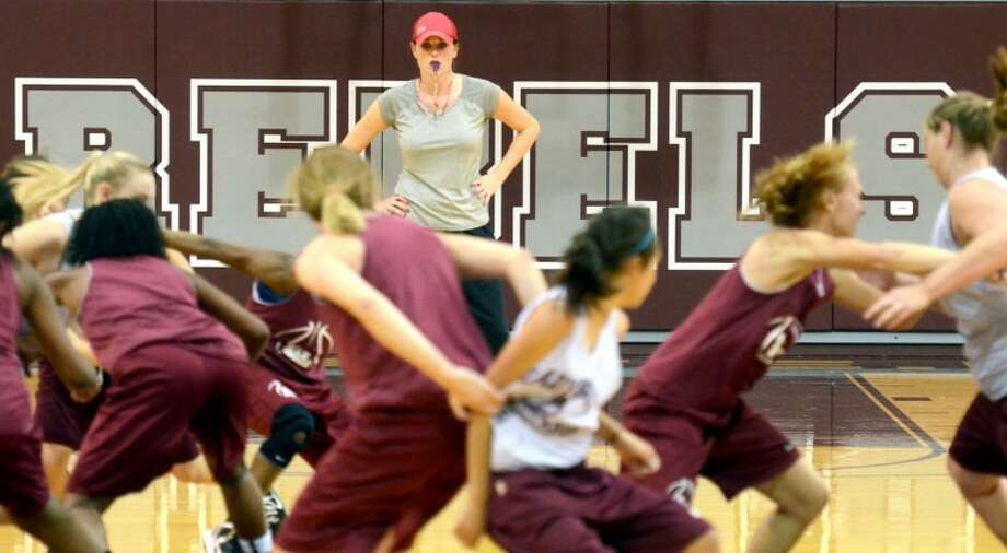 Lee High varsity girls basketball head coach Morgan Moylan looks on as her players participate in a boxing out drill Tuesday during practice at Lee High. James Durbin/Reporter-Telegram Photo: JAMES DURBIN