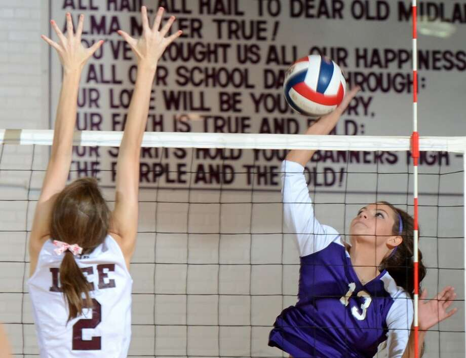 Midland High outside hitter Erin Robbins hits against Lee High Saturday at Midland High. Midland High beat Lee High 3-0. James Durbin/Reporter-Telegram Photo: JAMES DURBIN