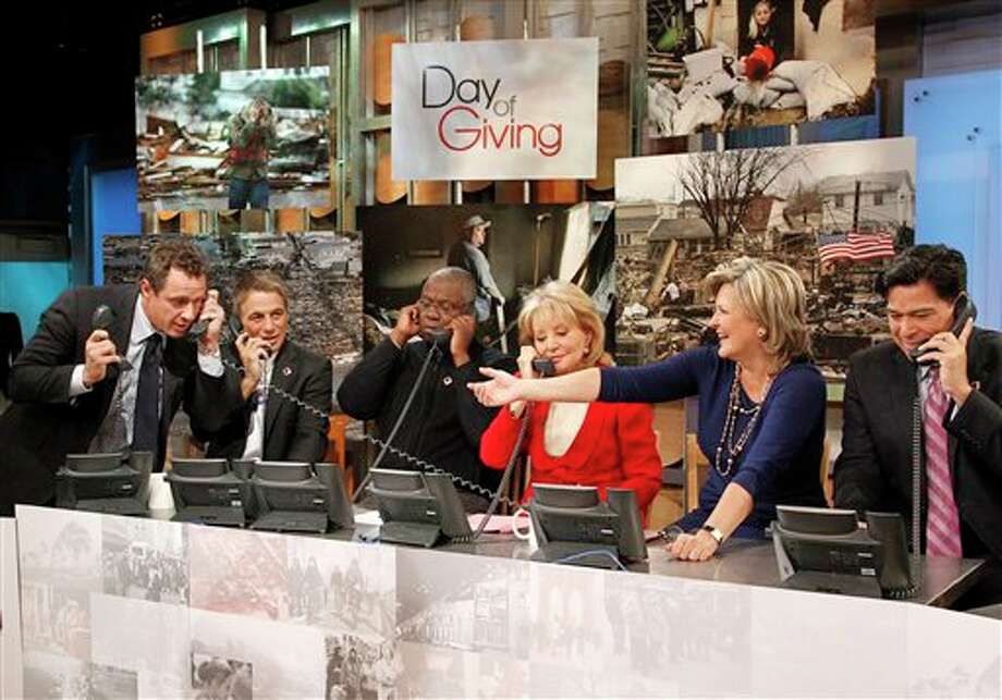 "This image released by American Broadcasting Companies shows, from left, ABC News' Chris Cuomo, actor Tony Danza, actor Andre Braugher, Barbara Walters, Cynthia McFadden and David Novarro manning phones to take donations for victims of Hurricane Sandy during ""Good Morning America,"" Monday, Nov. 5, 2012 in New York. Walters made a contribution of $250,000 to the American Red Cross and GMA co-host George Stephanopoulos followed suit with a donation for $50,000.(AP Photo/American Broadcasting Companies, Lou Rocco) Photo: Lou Rocco / American Broadcasting Companies,"