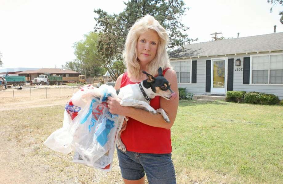 Linda Stoner is renting this home located in the 1900 block of Northrup Drive. Stoner is not happy with the relocating or demolishing of homes, located north and south of her residence, to make room for the Midland Christian teachers and visitors parking lot. The inability to control the debris and trash that is landing in her yard and the dust that she believes is causing her dogs allergies are among thereasons she is unhappy with the project. Cindeka Nealy/Reporter-Telegram Photo: Cindeka Nealy