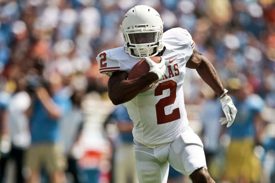 Texas running back Foswhitt Whittaker runs for a touchdown during the first half of an NCAA college football game against UCLA, Saturday, Sept. 17, 2011, at the Rose Bowl in Pasadena, Calif. (AP Photo/Bret Hartman) Photo: BRET HARTMAN / FR139655 AP