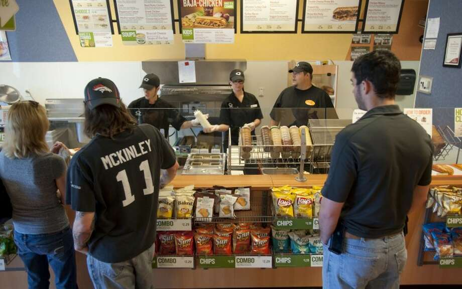 Staff at Quizno's on Andrews Highway take and make orders Tuesday afternoon. Tim Fischer\Reporter-Telegram Photo: Tim Fischer