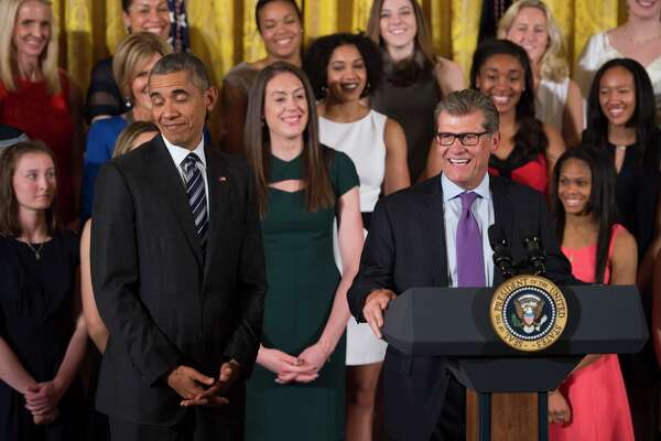 US President Barack Obama reacts as UConn Huskies Head Coach Geno Auriemma speaks at the White House in Washington, DC, May 10, 2016, during an event welcoming the 2016 NCAA Champion UConn Huskies women's basketball team.