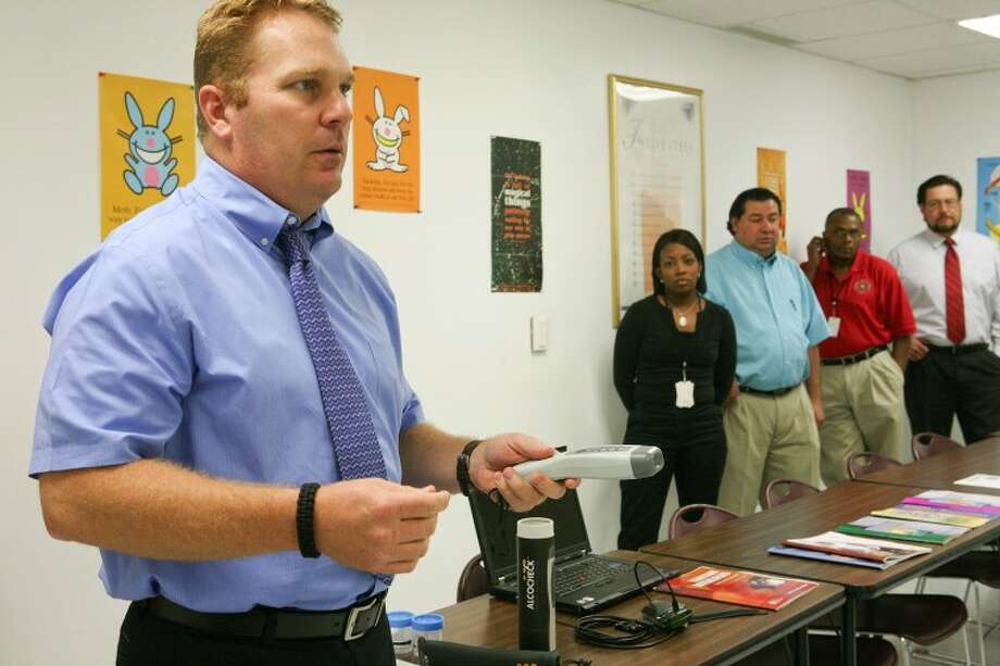 Midland Judicial District, Community Supervision and Corrections Department, Agency Director Jed Davenport talks about some of the new devices and programs that probation officers are using to monitor and help probationers, kick their habits, while under their supervision. Cindeka Nealy/Reporter-Telegram Photo: Cindeka Nealy