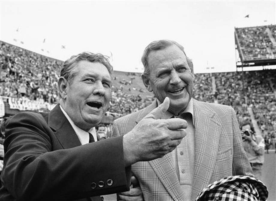 "FILE - This Dec. 30, 1972 file photo shows Alabama coach Paul ""Bear"" Bryant, left, and Texas coach Darrell Royal talking with reporters prior to their meeting in the Cotton Bowl on Jan. 1. The University of Texas says former football coach Darrell Royal, who won two national championships and a share of a third, has died. He was 88. UT spokesman Nick Voinis on Wednesday, Nov. 7, 2012 confirmed Royal's death in Austin.(AP Photo/File) Photo: Uncredited / 1972 AP"