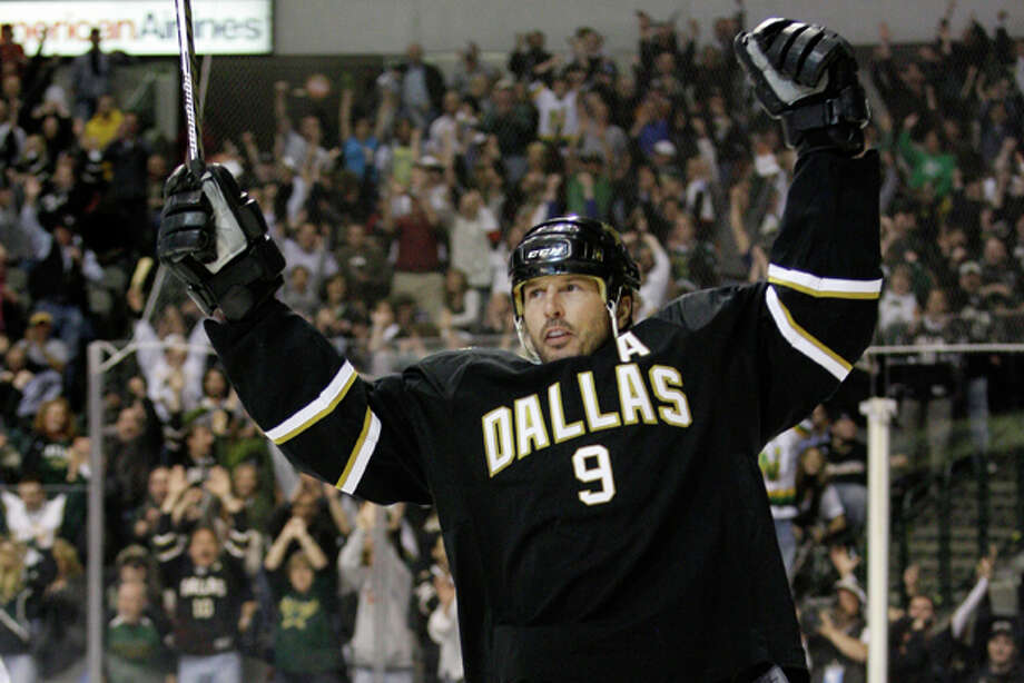 FILE - This April 8, 2010 file photo shows Dallas Stars' Mike Modano celebrating after scoring in the third period of an NHL hockey game against the Anaheim Ducks, in Dallas. Modano is retiring after 21 seasons in the NHL. Modano, in a phone interview Wednesday, Sept. 21, 2011, from Dallas, said he recently declined a chance to continue his career with the Vancouver Canucks. (AP Photo/Tony Gutierrez, File) Photo: Tony Gutierrez / AP2010