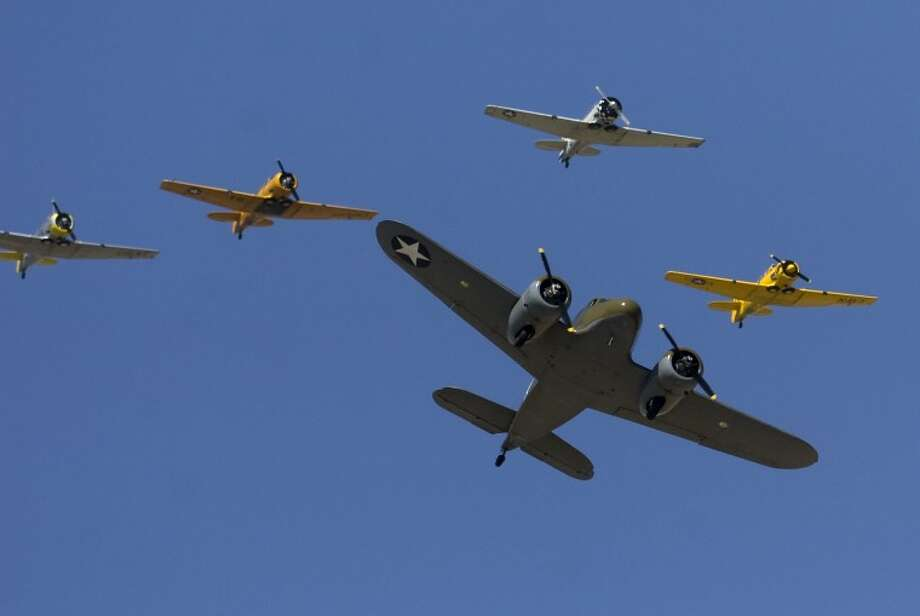 WWII planes fly in formation Saturday, Oct. 9 at the 2010 CAF AirSho. Photo by Tim Fischer/Midland Reporter-Telegram Photo: Tim Fischer