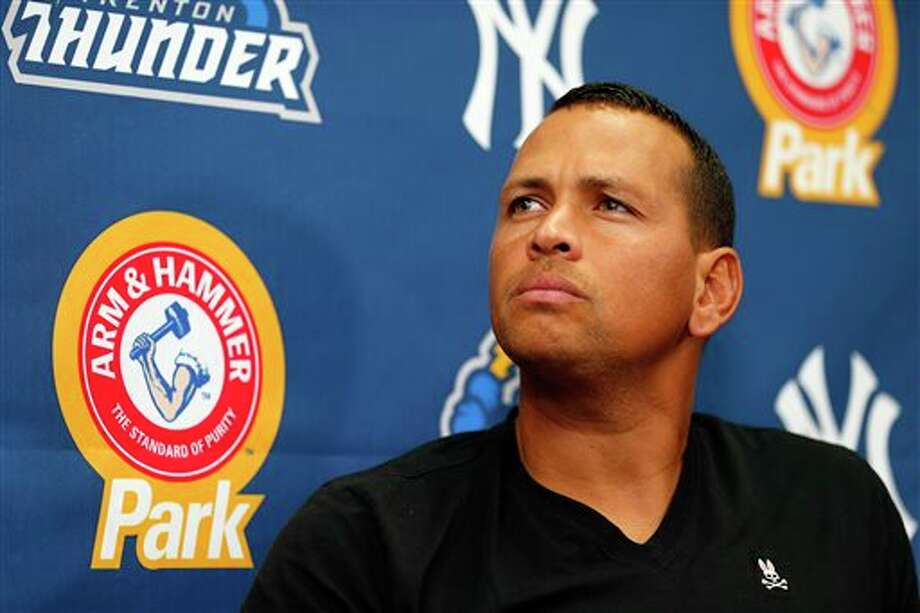 In this Aug. 3, 2013, photo, New York Yankees' Alex Rodriguez speaks to reporters during a news conference after a minor league baseball rehab start with the Trenton Thunder in a game against the Reading Fightin Phils, in Trenton, N.J. A person familiar with deliberations tells The Associated Press that Major League Baseball has informed the New York Yankees that Rodriguez will be suspended Monday, Aug. 5, 2013, but can play while he appeals the penalty. (AP Photo/Rich Schultz) Photo: Rich Schultz / THE ASSOCIATED PRESS2013