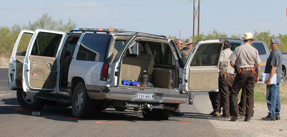 DPS Troopers and Ector County Sheriff's Deputies work the scene where a high speed chase ended at 16th Street and Avenue G Tuesday morning after DPS Troopers shot out the tire of the white GMC Suburban. Photo: Mark Sterkel|Odessa American