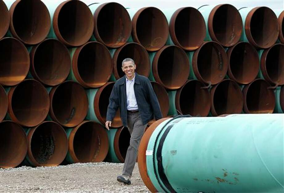 "FILE - This March 22, 2012 file photo shows President Barack Obama arriving at the TransCanada Stillwater Pipe Yard in Cushing, Okla. Obama has revived debate about the number of jobs that would be created by the proposed Keystone XL oil pipeline from Canada to Texas. The 1,700-mile pipeline would carry oil from tar sands in Alberta to refineries in the Houston area, passing through Montana, South Dakota, Nebraska, Kansas and Oklahoma. During a jobs speech Tuesday, July 30, 2013, in Tennessee, Obama downplayed the pipeline's effect on jobs, calling it a ""blip"" compared to the overall economy. He also made that point during an interview with The New York Times last week. (AP Photo/Pablo Martinez Monsivais, File) Photo: Pablo Martinez Monsivais / AP"