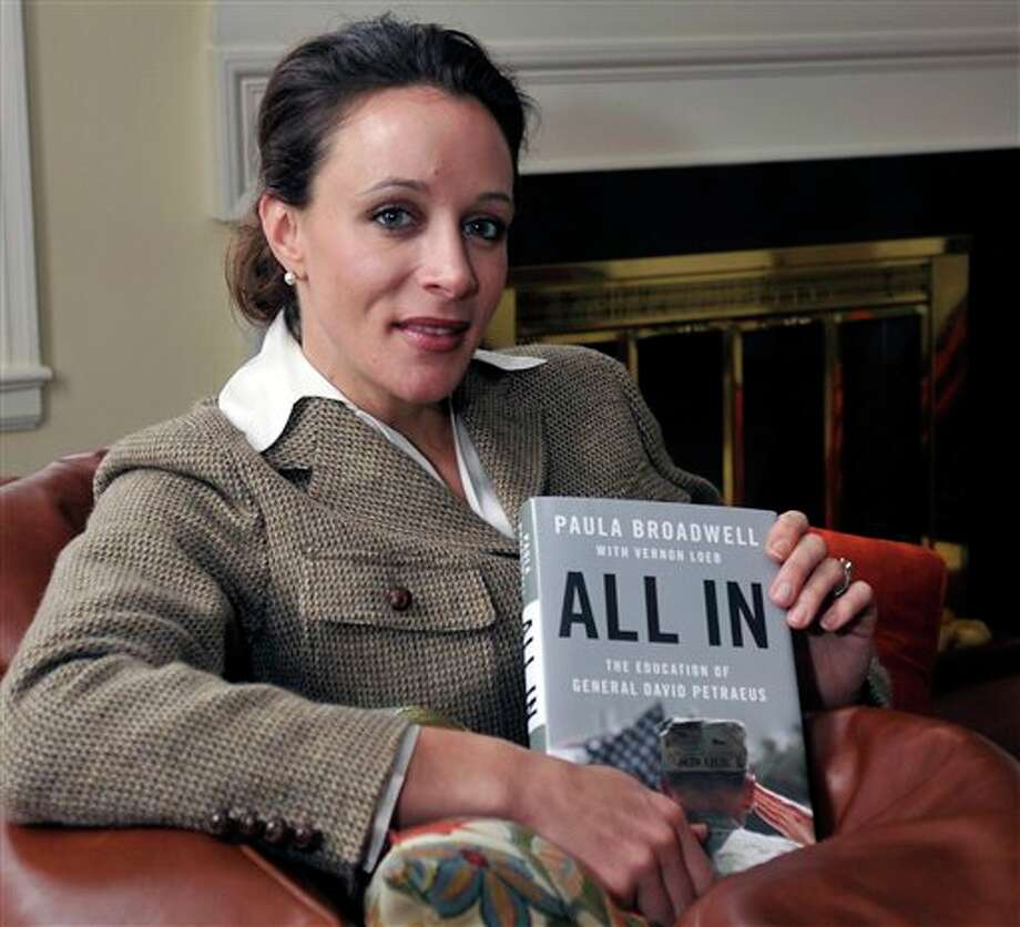 "In this Jan. 15, 2012 photo, Paula Broadwell, author of the David Petraeus biography ""All In,"" poses for photos in Charlotte, N.C. Petraeus, the retired four-star general renowned for taking charge of the military campaigns in Iraq and then Afghanistan, abruptly resigned Friday, Nov. 9, 2012 as director of the CIA, admitting to an extramarital affair. Petraeus carried on the affair with Broadwell, according to several U.S. officials with knowledge of the situation. (AP Photo/The Charlotte Observer, T. Ortega Gaines) LOCAL TV OUT (WSOC, WBTV, WCNC, WCCB); LOCAL PRINT OUT (CHARLOTTE BUSINESS JOURNAL, CREATIVE LOAFLING, CHARLOTTE WEEKLY, MECHLENBURG TIMES, CHARLOTTE MAGAZINE, CHARLOTTE PARENTS) LOCAL RADIO OUT (WBT) Photo: T. Ortega Gaines / The Charlotte Observer"