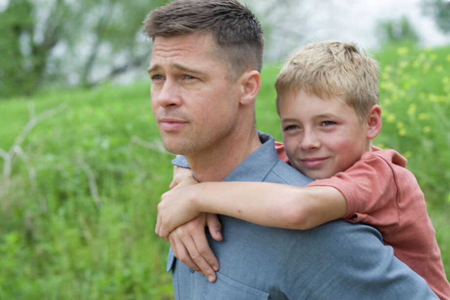 "In this film publicity image released by Fox Searchlight Pictures, Brad Pitt, left, and Laramie Eppler are shown in a scene from ""The Tree of Life."" (AP Photo/Fox Searchlight Pictures, Merie Wallace) Photo: Merie Wallace / AP2011"