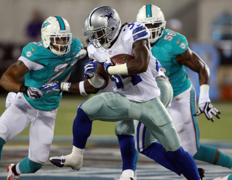 Dallas Cowboys running back Phillip Tanner (34) runs the ball for a 9-yard gain in the second quarter against the Miami Dolphins during the Pro Football Hall of Fame game Sunday in Canton, Ohio. (AP Photo/Scott R. Galvin) Photo: Scott R. Galvin