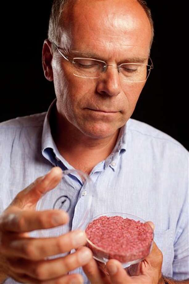 A new Cultured Beef Burger made from cultured beef grown in a laboratory from stem cells of cattle, is held by the man who developed the burger, Professor Mark Post of Netherland's Maastricht University, during a the world's first public tasting event for the food product in London, Monday Aug. 5, 2013. The Cultured Beef could help solve the coming food crisis and combat climate change according to the producers of the burger which cost some 250,000 euros (US dlrs 332,000) to produce. (AP Photo / David Parry, PA) UNITED KINGDOM OUT - NO SALES - NO ARCHIVES Photo: David Parry / PA