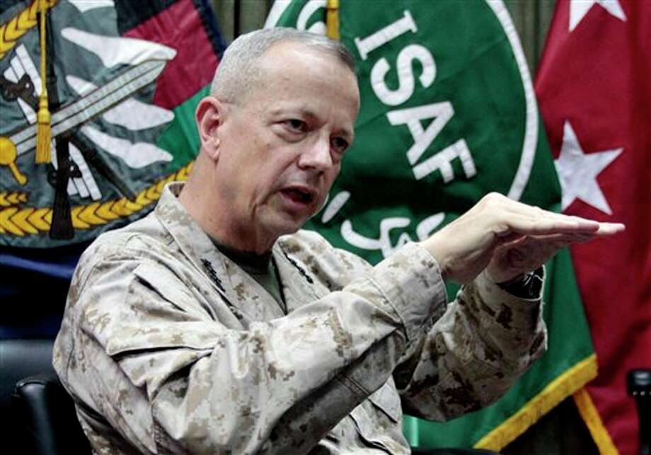 "FILE - This July 22, 2012, file photo shows U.S. Gen. John Allen, top commander of the NATO-led International Security Assistance Forces (ISAF) and U.S. forces in Afghanistan, during an interview with The Associated Press in Kabul, Afghanistan. The Pentagon says Gen. John Allen is under investigation for alleged ""inappropriate communications"" with Jill Kelley, the woman who is said to have received threatening emails from Paula Broadwell, the woman with whom former CIA Director David Petraeus had an extramarital affair. Defense Secretary Leon Panetta says the FBI referred the matter to the Pentagon on Sunday, Nov. 11, 2012. Panetta says he ordered a Pentagon investigation of Allen on Monday. (AP Photo/Musadeq Sadeq, File) Photo: Musadeq Sadeq / AP"